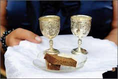 Lithuanian wedding tradition: the parents meet the young couple with bread, salt and two little glasses of water, which is supposed to ensure prosperity in their new life.