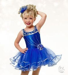 Curtain Call Costumes® - Party Time (Also in Blue, Red & Green) Mystique nylon/spandex and nylon/spandex leotard with sequin mesh bodice overlay and sequin and crystal embellishment. Attached tricot tutu with ruffle, sequin, and flower trim. INCLUDES: tricot and sequin flower barrette. Troupe price: $65 AUD - $70 AUD