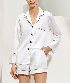 Crafted from satiny fabric with a hint of stretch, this long-sleeve button-up pajama set drapes you in the dreamy comfort you deserve.Size note: If you are between sizes and desire a looser fit, Pretty Bash recommends ordering the next size up. Please refer to the size chart for best fit.