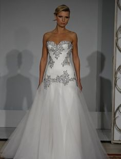 $13,000 later and you get a GORGEOUS wedding dress...