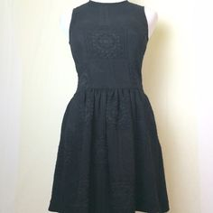 Zara black fit and flare dress This adorable sleeveless black dress has a quilted like pattern in a heavier fabric. It zips up the back and has pockets!  Like new. Zara Dresses