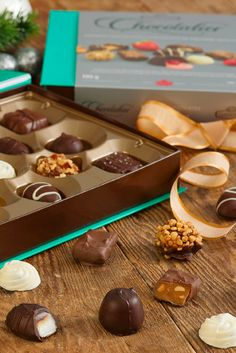 What gift do you give to someone who has it all? Our Chocolatier Premium Assortment, of course! Butcher Block Cutting Board, Gifts For Him, Holiday Gifts, Stuffed Mushrooms, Pudding, Candy, Holidays, Chocolate, Vegetables