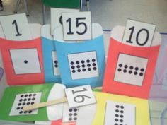 different math & lit. center ideas fromMrs. Bohaty's Kindergarten Kingdom blog. . . on this one she used library pockets and glued dot cards on them then laminated them then she glued the number cards on popsicle sticks