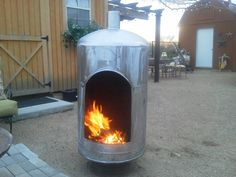 Water tank recycled into fireplace. Water Tank, Blossoms, Stove, My House, Recycling, Projects To Try, Home Appliances, Cool Stuff, Wood