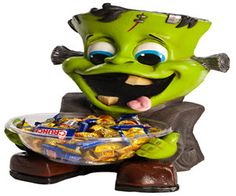 Little Frankenstein is sitting looking cute with his tongue out waiting to give you his candy. This cute Halloween Frankie candy bowl holder features a fun