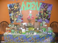 "Teenage Mutant Ninja Turtle Candy Buffet. There is a Happy Birthday Banner above ""Aden"" which doesn't show up in the picture."