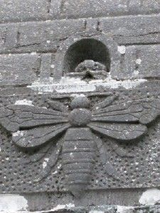(Sculptural detail of a bee from the well of Saint Gobnait.) In Ireland the Patron Saint of beekeeping is Saint Gobnait. The community of Bullyvourney, County of Cork, Ireland still holds a celebration on Feb 11 in her honour. A Mass is held and attendees are encouraged to take water from the well.