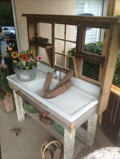 I saw this potting bench at a local antique shop. I must build one. I have two old porcelain sinks, just like this one, and can't believe I never thought of doing this. Love it.