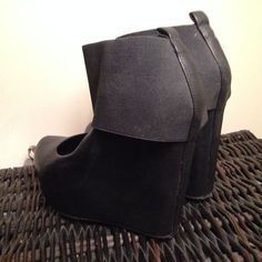 Available @ TrendTrunk.com Black edgy wedges. By Aldo Shoes . Only $43!