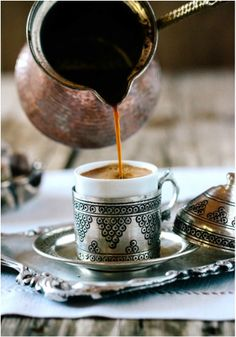 For perfect coffee, first put two cups of water in the cezve, and then add two spoons of Turkish coffee. When the coffee starts to boil, a thin layer of foam will appear on the surface of the liquid. Using a spoon, distribute this foam among the cups. Then boil the coffee in the cezve until it foams up again, and break it among the cups.