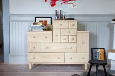 "IKEA PS 2012 chest of drawers   Tinted and clear lacquered pine. Designer: Ehlén Johansson. Requires assembly. Pine  5-drawer/1-door chest $399 W51½×D18⅞×H33⅞"". 102.194.56"