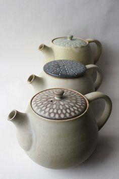 Mayumi Yamashita | Variations of her 'Eve' teapot, with fluted incisions for decoration.