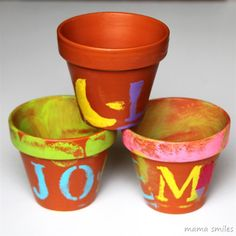 These child-painted terra cotta clay pots make wonderful Mother's Day and teacher gifts!