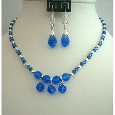 Price :$34.50 Swarovski Sapphire Montana Crystal Necklace Handcrafted Custom Jewelry apphire Color always give rich look & when we use Swarovski Crystals that also Sapphire make you look rich automatically this Set is combination of Sapphire & Montana Swarovski Crystals round the neck. To look more elegant Crystals Ball 8mm is used at Necklace.