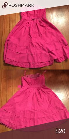 Strapless dress 👗from The Limited Gorgeous strapless pink dress from The Limited with a bow detail around the waist. Bottom is tiered. Perfect to wear to a wedding or a night out on the town! Never worn. The Limited Dresses Strapless