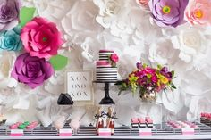 Paper flower wall. Styled by Sarah Sull of August In Bloom. Photo by SLG Photography (via Best Friends for Frosting).