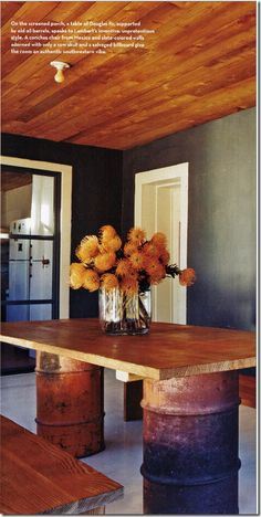 """This room almost feels """"upside down""""- and it works.  Light flooring (usually light ceiling), dark wall color (looks gorgeous yet a bit rustic), and wood toned ceiling (usually this is found on the floor) come together nicely."""