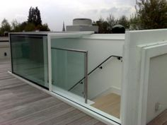 Bespoke designed electric Sliding Box All the glass used is flush to allow water run off and easy cleaning, whilst maintaining maximum security.