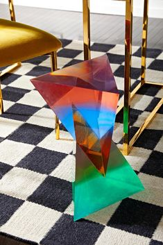 """by Jonathan Adler We harnessed the optical majesty of acrylic to create the perfect perch for drinks. Our elemental Neo Geo Drinks Table is made from counterbalanced pyramids of jewel-toned acrylic that visually meld to look different from every angle. A functional sculpture that adds Pop Art panache to your Park Avenue pad. 12"""" W, 12"""" D, 18"""" H Multicolored acrylic To best preserve its clear lucidity, keep out of direct sunlight Minor scratches can be buffed out by hand with a soft dry cloth. Im Classic Furniture, Modern Furniture, Furniture Design, Furniture Market, Furniture Decor, Neo Geo, Drink Table, Contemporary Classic, Modern Art"""