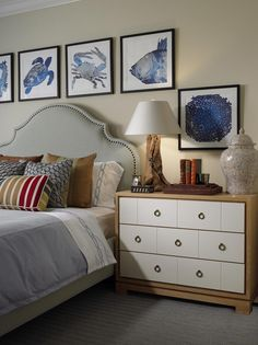 Love these nautical prints surrounding the headboard - CHIC COASTAL LIVING: Chic Designer {Cindy Ray Interiors}