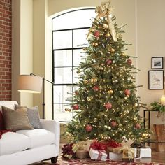 Hedon Lighted Tree | Give your home a festive look with this pre-lit holiday tree. With over 1,000 LED lights, this tree is sure to cast a luminous glow in your living room or entryway.