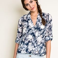 Floral Envelope Blouse ARRIVING MAY 19 2016. Floral envelope faux wrap blouse. Available in navy and mocha. This listing is for the NAVY. Brand new. True to size. Model is wearing the size small. NO TRADES DON'T ASK. Bare Anthology Tops Blouses
