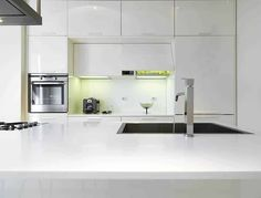 Modern kitchen with silgranit sink in island and lacquer cabinets High Gloss Kitchen Cabinets, Modern Kitchen Design, Kitchen Designs, Sink In Island, Painting Cabinets, Cabinet Design, White Kitchens, Furniture