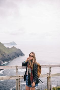 Gal Meets Glam Ring Of Kerry - Barbour coat, Ralph Lauren sweater, Gap shirt, Sézane skirt, Patagonia backpack, and Ray Ban sunglasses