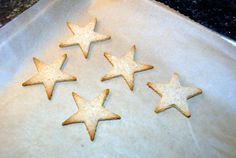 Paleo Star Cookies made with a star shaped cookie cutter use heart healthy almond flour and coconut oil for a delicious holiday treat.