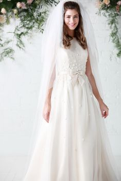 'Hepburn', RRP £1,350 Hepburn is the pretty floral and pretty organza gown of the collection with stunning back detail & satin bow belt. Hepburn is simply stunning & perfect for 1950's inspired Audrey Hepburn styling.