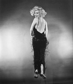 "Marilyn Monroe ""jumps"" for photographer Philippe Halsman, 1959."