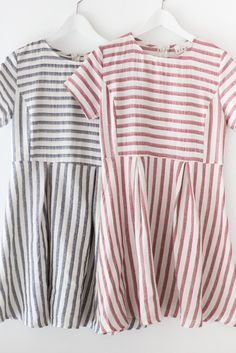 "Striped short sleeve fit and flare dress. Made with high quality woven cotton material that is non-stretch. Size small measures approx. 33"" in length. This dress has a slightly loose fit. Back zipper"