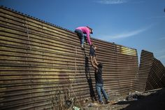 Central American migrants climb the border fence between Mexico and the United States, near El Chaparral border crossing, Tijuana, Baja… World Press Photo, Across The Border, Supreme Court, S Pic, Asylum, Photo Contest, Ny Times, United States, Time Magazine