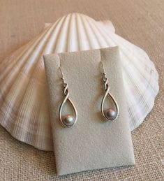 Sterling Silver Earrings Twist and Shout Pearl Earrings -Add on - Twist and Shout Earrings will accentuate a set of Matching pearls from Nicoga Pearls. Two matching Pearls or a Twin Oyster Opening is included. Oyster Openings are done Tuesday Black Pearl Earrings, Pearl Studs, Sterling Silver Earrings, Gold Earrings, Earring Studs, Minimalist Earrings, Minimalist Jewelry, Twist And Shout, Fashion Earrings