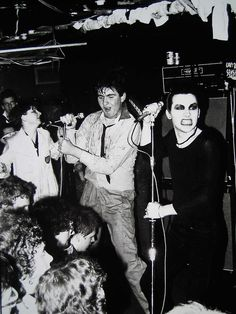 """""""Dave Vanian of the Damned was joined by a member of the audience for a number or until he was thrown back into the crowd.(The Roxy 1977)"""" via"""