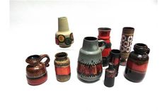 A GROUP OF NINE WEST GERMAN ART POTTERY VASES the largest a Bay Keramik red ground vase decorate