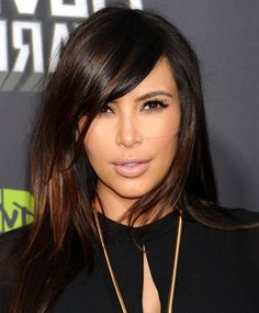 Kim Kardashians Long Tousled Brunette Hairstyle With Braids And ...