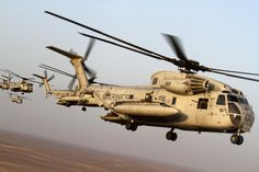 U.S. Marine Corps CH-53D Sea Stallion helicopters with Marine Heavy Helicopter Squadron (HMH) 362 complete a formation flight over Helmand province, Afghanistan