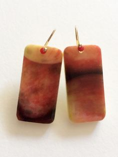 A personal favorite from my Etsy shop https://www.etsy.com/listing/224782889/macintosh-apples-domino-jewelry-red