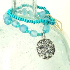 Lace Sand Dollar Charm Bracelet with Hawaiian Recycled glass and vintage beads