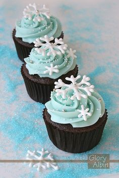 make snowflakes out of melted white chocolate piped into desired shape, take white frosting and add blue food coloring
