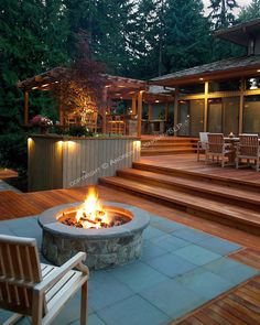 An amazing outdoor space... A 1700 square foot, 2-level deck, outdoor kitchen, and firepit complete the outside of this ranch-style home tucked among towering fir trees in a Seattle suburb.