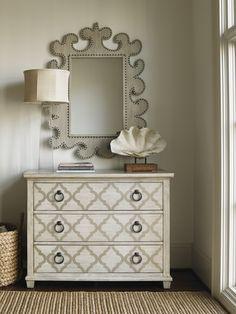 Designer vertical mirror featuring unique cutouts and nailhead trim pattern.  #LHBDesign