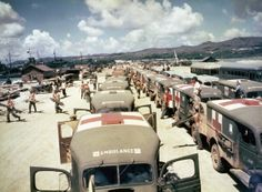 View of military ambulances lined up on shore at Guam, awaiting the arrival of the USS Solace with casualties from Okinawa, June 1945. (Photo by PhotoQuest/Getty Images)
