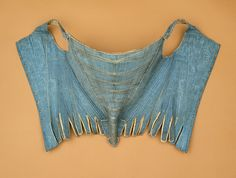 Pair of stays, silk moire lined with linen, bound with silk ribbon and trimmed with silk cording, c. 1730-40, English.