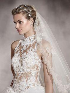 Gorgeous sleeveless lace high neck wedding dress; Featured Dress: Pronovias