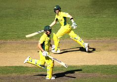 Steve Smith (R) and Aaron Finch (L) of Australia run between wickets during the 2015 Cricket World Cup Semi Final match between Australia and India at Sydney Cricket Ground on March 26, 2015 in Sydney, Australia.