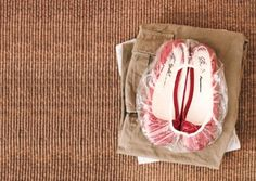 Pack your dirty shoes in a shower cap.