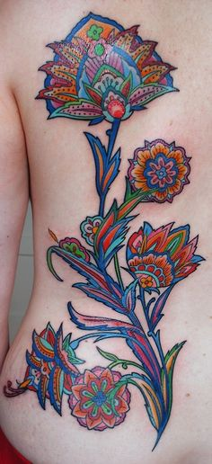 Paisley-inspired back tattoo by artist Barbara Swingaling from the body art shop Classic Ink and Mods in Amsterdam, Netherlands