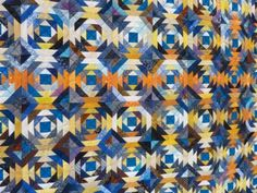 A pineapple block quilt. Controlled scrappy - interesting placement of the orange scraps.